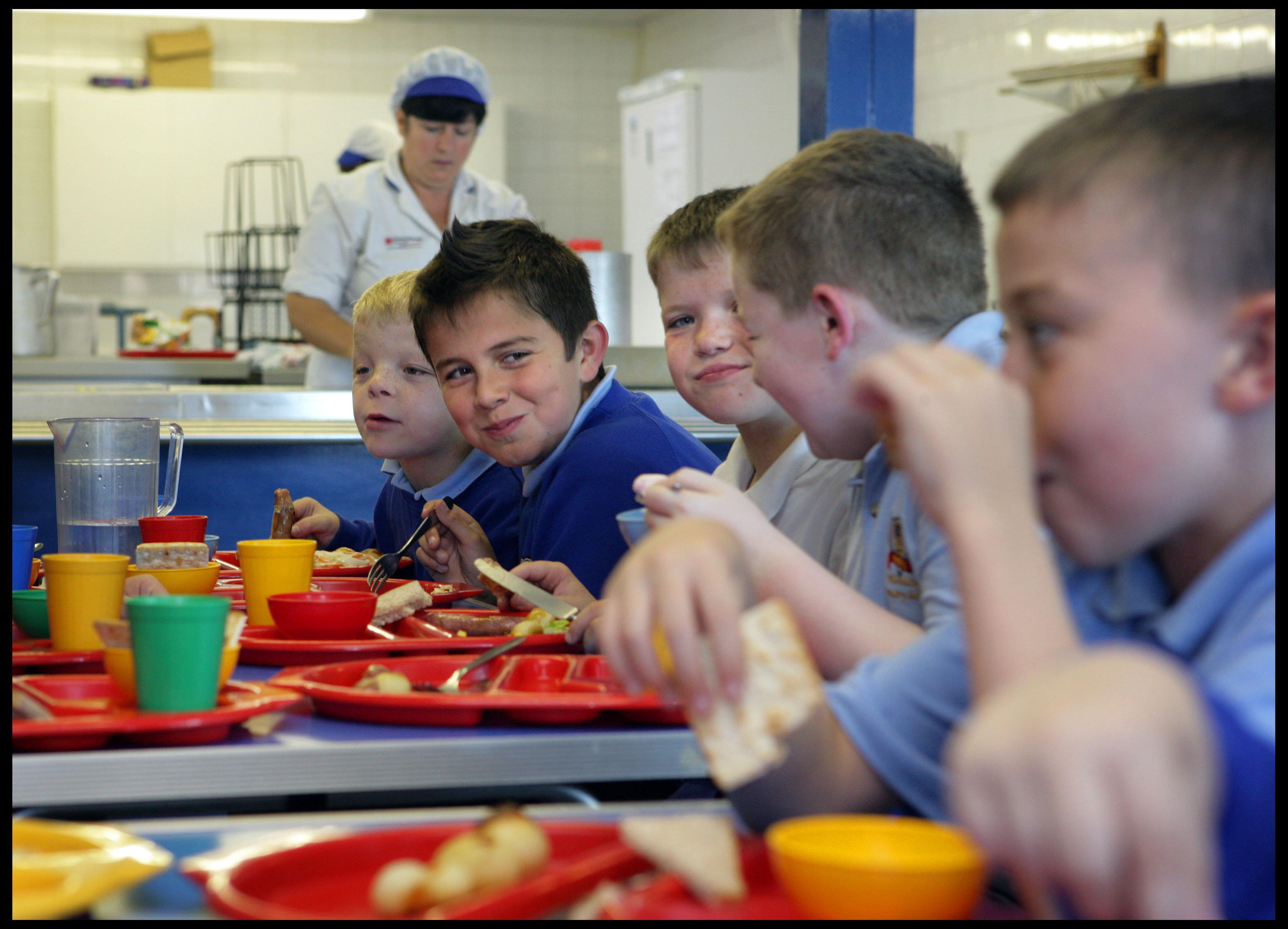 Boys eating school meals