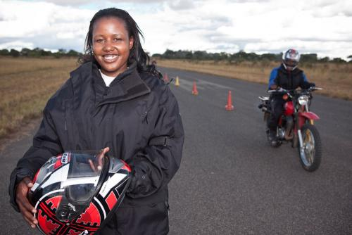 Smiling Woman and Motorcyclist