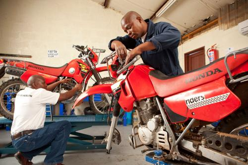 Mechanics Maintaining Motorcycles